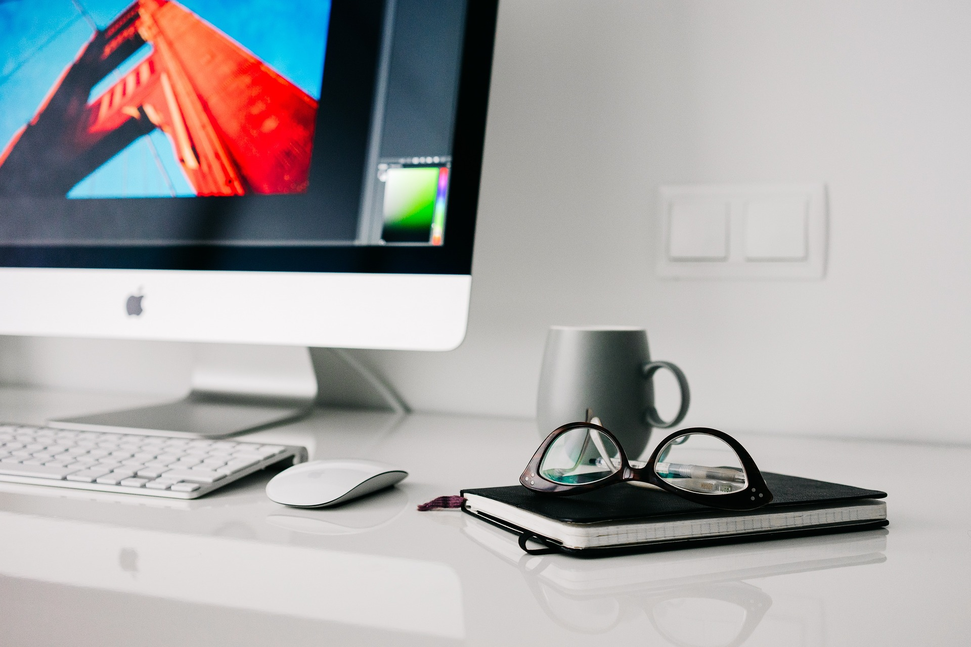 image of computer, coffee cup and glasses