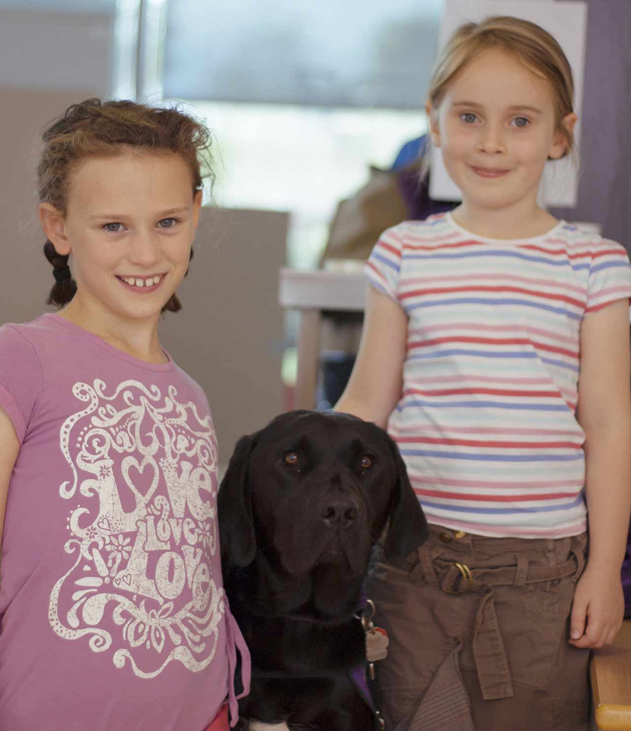 Two children and an assistance dog